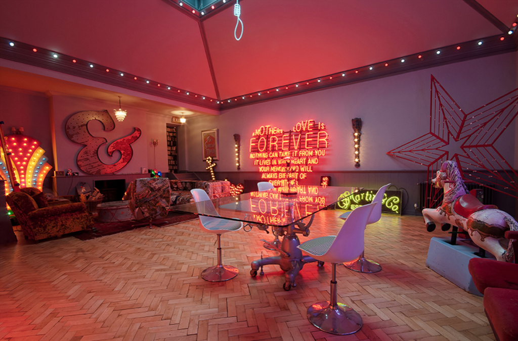 A gigantic live, eat space is the centre attraction with the main ceiling light in the shape of a noose